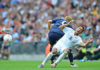 August 07, 2012..Mexico's Marco Fabian is tackled by Japan defender during Men's Semifinal match at the Wembley Stadium on day eleven in Wembley, United Kingdom. Mexico defeat Japan 3-1 to reach Mean's Football Finals of the 2012 London Olympics.