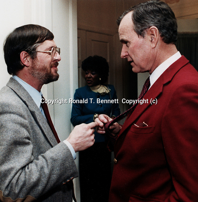 Ron Bennett and Pres. George Bush check out ties, Photojournalism, Political, News, Sports, Features, Hollywood