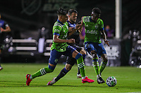 10th July 2020, Orlando, Florida, USA;  San Jose Earthquakes midfielder Vako (11), Seattle Sounders defender Xavier Arreaga (3) and Seattle Sounders defender Kelvin Leerdam (18) go for the ball during the soccer match between the Seattle Sounders and the San Jose Earthquakes on July 10, 2020, at ESPN Wide World of Sports Complex in Orlando, FL.