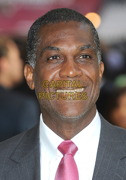 MICHAEL HOLDING.European Premiere of 'Fire in Babylon' at the Odeon, Leicester Square, London, England, UK, May 9th 2011..headshot portrait grey gray black pink smiling .CAP/BEL.©Tom Belcher/Capital Pictures.