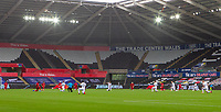 18th July 2020; Liberty Stadium, Swansea, Glamorgan, Wales; English Football League Championship, Swansea City versus Bristol City; All players take a knee before kick off