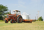 IH Farmall Model 856 tractor (1970), disc, grain storage tanks