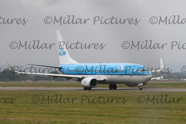 A Boeing 737-8K2 Registration PH-BXK of KLM taxiing at Glasgow Airport bound for Schipol Airport, Amsterdam on 29.9.14.