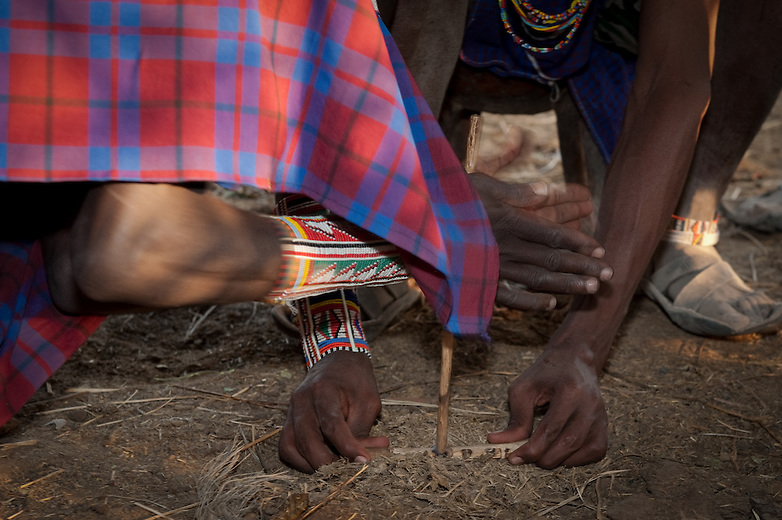 While out there in the bush and far away from any source of fire, Maasai men will make fire by rubbing two pieces of wood together. One man holds a piece of wood horizontally and firmly to the ground while the other rubs a harder piece of stick to the horizontal one in one place vigorously to make an indention.