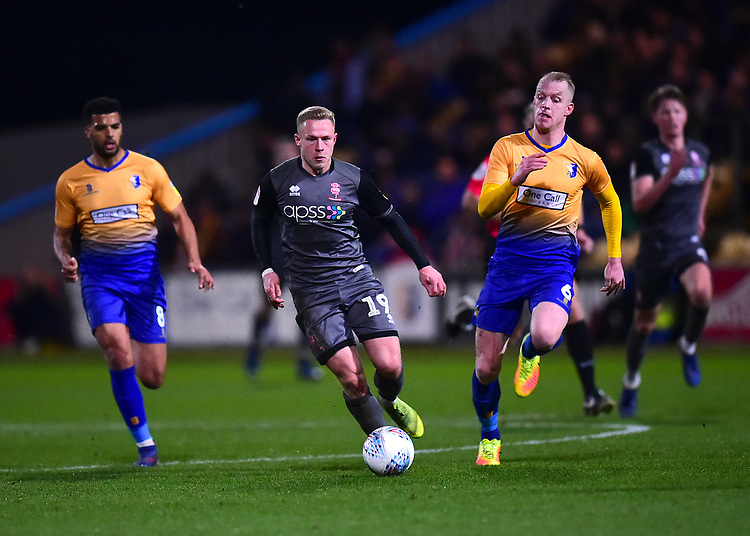 Lincoln City's Danny Rowe vies for possession with Mansfield Town's Neal Bishop<br /> <br /> Photographer Andrew Vaughan/CameraSport<br /> <br /> The EFL Sky Bet League Two - Mansfield Town v Lincoln City - Monday 18th March 2019 - Field Mill - Mansfield<br /> <br /> World Copyright © 2019 CameraSport. All rights reserved. 43 Linden Ave. Countesthorpe. Leicester. England. LE8 5PG - Tel: +44 (0) 116 277 4147 - admin@camerasport.com - www.camerasport.com