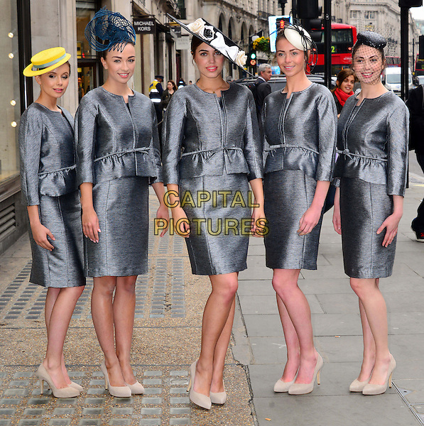Amber Le Bon & models.British model Amber Le Bon launches Royal Ascot's 2013 Dress Code Assistants' outfits, supplied by Hobbs London, Hobbs, London, England..May 22nd, 2013.full length grey gray dress skirt blazer jacket hat peplum beige shoes .CAP/BF.©Bob Fidgeon/Capital Pictures