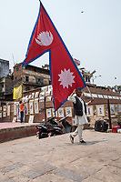 Nepal, Kathmandu, Durbar Square. Man with Nepal flag.