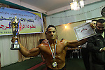Palestinian men take part during competing in a bodybuilding contest at a hall in Gaza city, Friday, April 22, 2011. Many of the men use women's cosmetics, mud, or paint to enhance their muscles. Number of men from around the Gaza Strip competed Friday in the territory's bodybuilding championship. Participants say the Israeli blockade makes it harder for them to pump up and prevents them from participating in championships outside of the impoverished territory. Photo by Naaman Omar