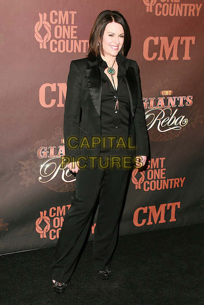 MEGAN MULLALLY.At CMT Giants honoring Reba McEntire held at the Kodak Theatre, Hollywood, LA, California, USA.26 October 2006..full length black trouser suit  green necklace.Ref: ADM/CH.www.capitalpictures.com.sales@capitalpictures.com.©Charles Harris/AdMedia/Capital Pictures.