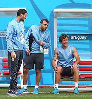 Diego Lugano of Uruguay (right) sits and watches training as he misses out on tomorrow's match vs England through injury