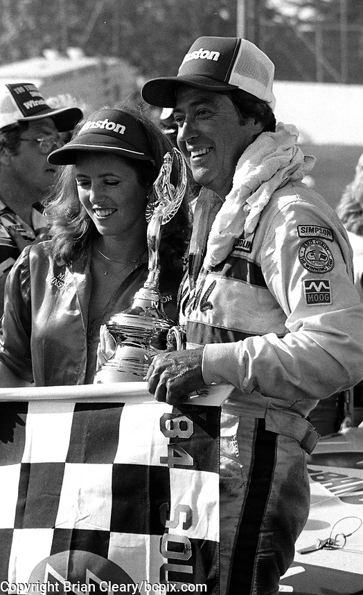 Harry Gant celebrates after winning the Southern 500 at Darlingotn Raceway in Darlington, SC on September 2, 1984.  (Photo by Brian Cleary/www.bcpix.com