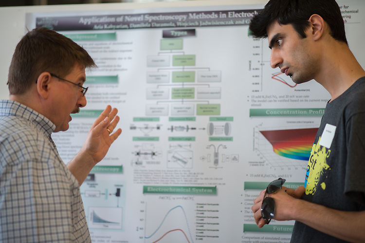 Wojciech Jadwisienczak (Left), Associate Professor in Electrical Engineering and Computer Science, discusses research with Ohio University student Aria Kahyarian at the Student Expo in the Convocation Center on Thursday, April 11, 2013. Photo by Ben Siegel