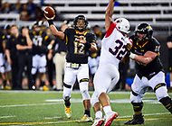 Baltimore, MD - OCT 14, 2017: Towson Tigers quarterback Triston Harris (12) throws a pass over Richmond Spiders defensive lineman Brandon Waller (32) during game between Towson and Richmond at Johnny Unitas Stadium in Baltimore, MD. The Spiders defeated the Tigers 23-3. (Photo by Phil Peters/Media Images International)