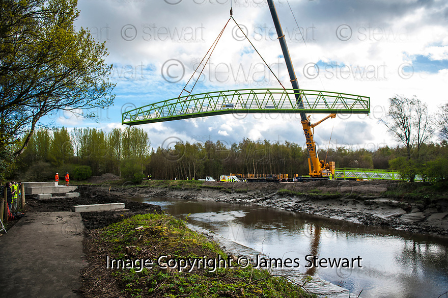 The new bridge linking Carronshore with the Abbotshaugh Woods is lifted in to position.