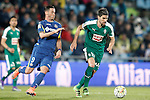 Getafe's Alvaro Vazquez (l) and Sociedad Deportiva Eibar's Adrian Gonzalez during La Liga match. March 18,2016. (ALTERPHOTOS/Acero)