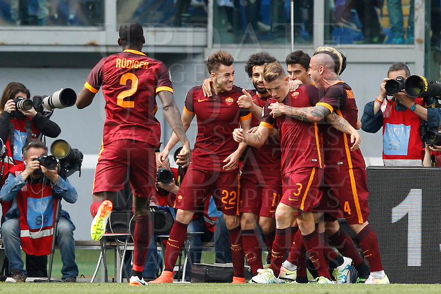 Calcio, Serie A: Lazio vs Roma. Roma, stadio Olimpico, 3 aprile 2016.<br /> Roma's Stephan El Shaarawy, second from left, celebrates with teammates after scoring during the Italian Serie A football match between Lazio and Roma at Rome's Olympic stadium, 3 April 2016.<br /> UPDATE IMAGES PRESS/Riccardo De Luca