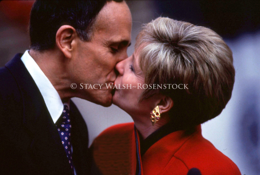 (011222-SWR05.jpg) 2JAN94- New York, NY - Mayor Rudolph W. Giuliani and his second wife, wife Donna Hanover Giuliani , kiss during Rudy's mayoral inauguration ceremony at City Hall.<br /> <br /> In December 2001 Diuliani announced during a news conference that he and Donna Hanover were splitting.<br /> <br />  &copy;Stacy Walsh Rosenstock