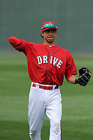 Infielder Mauricio Dubon (10) of the Greenville Drive during a Media Day first workout of the season on Tuesday, April 7, 2015, at Fluor Field at the West End in Greenville, South Carolina. (Tom Priddy/Four Seam Images)