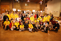 "Tuesday February 16, 2010.  Volunteers at the Iditarod musher's ""food drop"" stop to pose for a group photo."