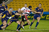 Siale Piutau fights his way past Ben Nolan & Jason MacDonald. Air New Zealand Cup rugby game played at Mt Smart Stadium, Auckland, between Counties Manukau Steelers & Otago on Thursday August 21st 2008..Otago won 22 - 8 after leading 12 - 8 at halftime.