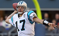 Carolina Panthers quarterback Jake Delhomme (17) looks down the field before making throw in the game on Oct. 31, 2004 at Qwest Field in Seattle.