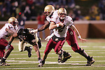 4 November 2006: Boston College quarterback Matt Ryan (12) scrambles after being flushed out of the pocket by Wake Forest's Jeremy Thompson (2nd from left). Wake Forest defeated Boston College 21-14 at Groves Stadium in Winston-Salem, North Carolina in an Atlantic Coast Conference college football game.