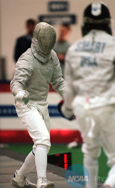 22 Mar 1997: Sergey Lilov (L) of Penn State battles Keith Smart (R) of St. John's for the sabre title during the Division 1 Men's and Women's Fencing Championships at the Air Force Academy Cadet Gymnasium in Colorado Springs, CO. Smart defeated Lilov for the national title. David Zalubowski/NCAA Photos.