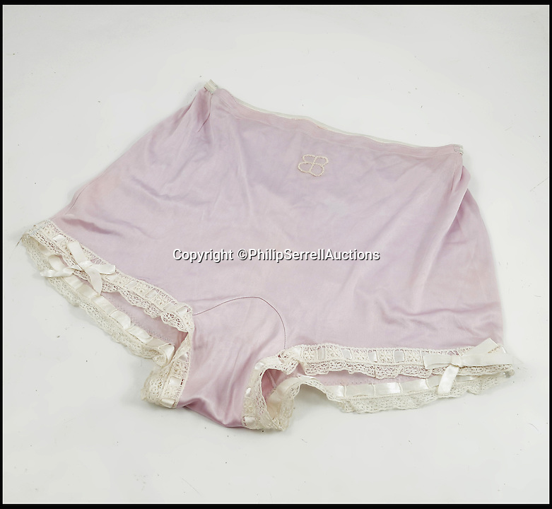 BNPS.co.uk (01202 558833)<br /> Pic: PhilipSerrellAuctions/BNPS<br /> <br /> Nazi swas-knickers... Eva Braun's lace and ribbon under garments.<br /> <br /> A pair of silk frilly knickers worn by Adolf Hitler's mistress Eva Braun for the Nazi dictator have sold at auction for almost &pound;3,500.<br /> <br /> The pair of lilac undies, that have Braun's monogrammed initials embroidered on the front of them, got pulses racing when they went under the hammer. <br /> <br /> The Nazi swas-knickers were liberated by an American serviceman who found them in an abandoned bunker in the Platterhof Hotel next to Hitler's Berghof home in the Bavarian Alps.<br /> <br /> The soldier kept them as a souvenir and took them back to the US with him after the Second World War.
