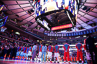 NEW YORK, NY - Sunday December 13, 2015: Players stand for the national anthem.  St. John's defeats Syracuse 84-72 during the NCAA men's basketball regular season at Madison Square Garden in New York City.