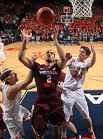 Virginia Tech forward Joey Van Zegeren (2) reaches for the rebound with Virginia forward Caid Kirven (24) during the game Tuesday in Charlottesville, VA. Virginia defeated Virginia Tech73-55.