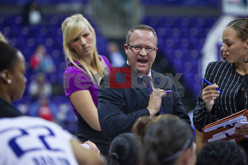 Megan Osmer - Director of Basketball Operations and Assistant coaches Mike Neighbors, Adia Barnes --  The University of Washington Huskies women's basketball team defeats the Seattle University Redhawks 72-53 at Hec Ed Pavilion at Alaska Airlines Arena Wednesday, Nov. 16, 2011. (Photo by Andy Rogers/Red Box Pictures)