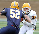 SIOUX FALLS, SD - MAY 4:  Justin Greenway #38 from Augustana's offense looks to make a move against Sam Thorson #52 from the defense during the Vikings Spring Game Saturday morning at Kirkeby-Over Stadium on the Augustana College Campus. (Photo by Dave Eggen/Inertia)