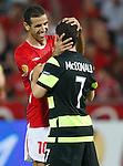 Walid Badir tries to rip off Scott McDonald's head for a souvenir