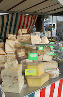 Cheese for sale on french market stall in the Bastille area of Paris,