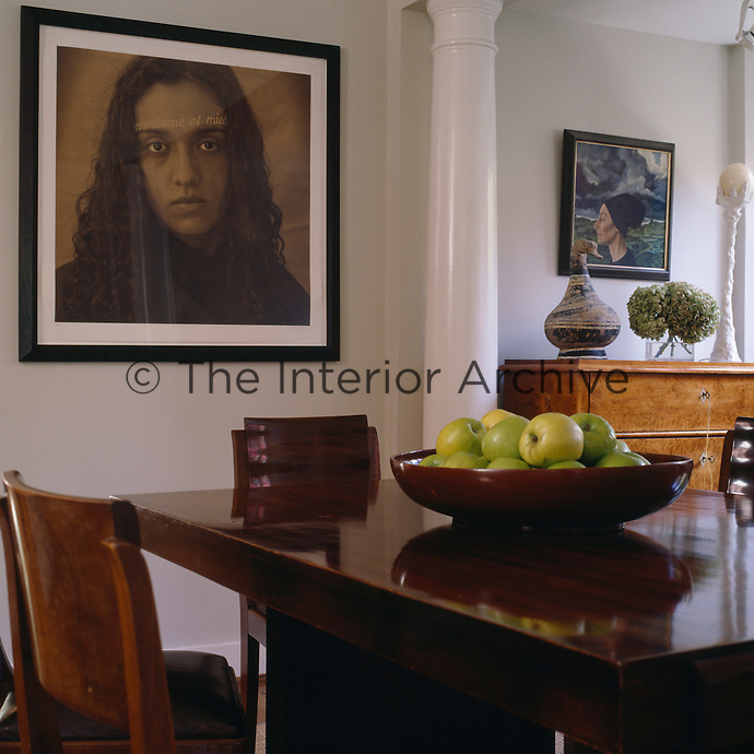 A portrait by Louis Gonzalez Palma overlooks the dining room table