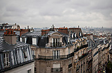 FRANCE, Paris, Parisian rooftops in Montmartre during the day, City view in the background