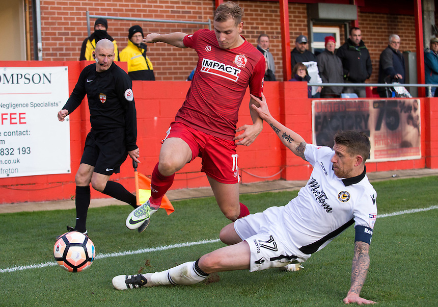 Adam Priestley of Alfreton Town is tackled by Scot Bennett of Newport County<br /> <br /> Photographer James Williamson/CameraSport<br /> <br /> The Emirates FA Cup First Round - Alfreton Town v Newport County - Sunday 6th November 2016 - North Street - Alfreton<br />  <br /> World Copyright &copy; 2016 CameraSport. All rights reserved. 43 Linden Ave. Countesthorpe. Leicester. England. LE8 5PG - Tel: +44 (0) 116 277 4147 - admin@camerasport.com - www.camerasport.com