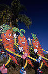 Vegetable patch with giant waving carrots with happy faces, San Diego, California USA