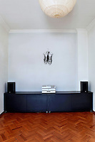 living room with black sideboard