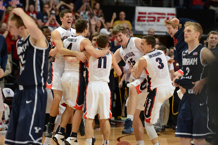 March 11, 2014; Las Vegas, NV, USA; Gonzaga Bulldogs celebrate against the Brigham Young Cougars after the game of the WCC Basketball Championships at Orleans Arena.