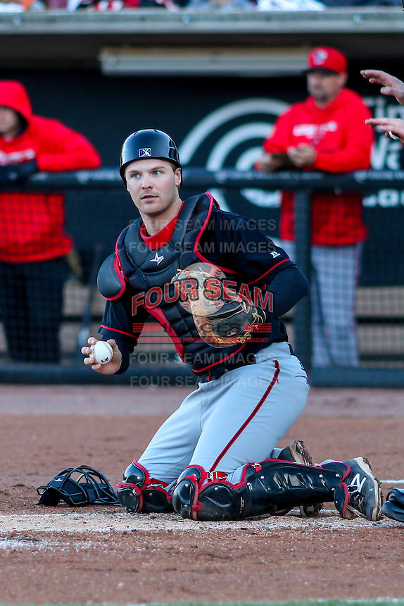 Lansing Lugnuts catcher Ryan Hissey (15) checks a runner after blocking a ball in the dirt during a Midwest League game against the Wisconsin Timber Rattlers on April 29th, 2016 at Fox Cities Stadium in Appleton, Wisconsin.  Wisconsin defeated Lansing 2-0. (Brad Krause/Four Seam Images)
