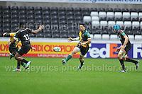 Northampton Saints George Pisi (centre) kicks through the Ospreys defenders. Liberty Stadium, Swansea, South Wales 12.01.14. Ospreys v Northampton Heineken Cup round 5 pool 1 - pIc credit Jeff Thomas photography