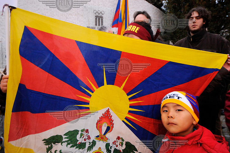 Young Tibetan demonstrator at a demonstation calling for a boycott of the opening ceremony, and lighting of the Olympic flame, for the 2008 Beijing Olympic Games. Switzerland is home not only to the head quarters of the International Olympic Committee, but also to Europe's largest Tibetan refugee community.