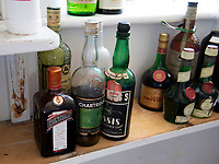 BNPS.co.uk (01202 558833)<br /> Pic: PhilYeomans/BNPS<br /> <br /> The house still contain's half empty drinks bottle in the larder.<br /> <br /> A remarkable 'time warp' Royal archive amassed by the Queen's dressmaker has been found inside his old country home.<br /> <br /> The late Ian Thomas was a dress designer for members of the Royal Family, including Her Majesty, for over 30 years.<br /> <br /> As an apprentice he worked alongside the renowned fashion designer Norman Hartnell on creating the Queen's coronation dress in 1953.<br /> <br /> His archive includes embroidered samples of the gown worn by Elizabeth II for the historic ceremony in Westminster Abbey that was broadcast to millions.<br /> <br /> Mr Thomas also designed outfits for the Queen Mother and Princess Margaret.