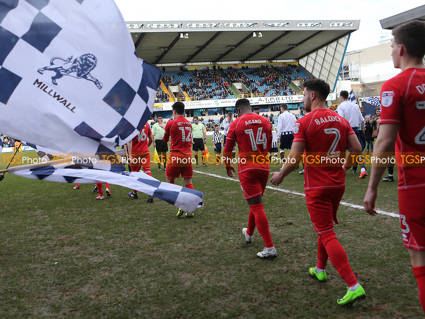 MK Dons players walk out onto the pitch ready for the start of the game during Millwall vs MK Dons, Sky Bet EFL League 1 Football at The Den on 4th March 2017