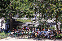 Crowds of burger lovers eat lunch at the Shake Shack in Madison Square Park in New York on Sunday, July 6, 2014.  After celebrating ten years in the park the popular eatery will temporarily close for improvements to its infrastructure. The hiatus will take place over the winter and not to worry, the chain has ten locations in New York to get a burger fix. (© Richard B. Levine)