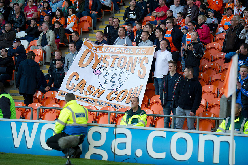 Blackpool fans protest against the clubs owner, Owen John Oyston<br /> <br /> Photo by Stephen White/CameraSport<br /> <br /> Football - The Football League Sky Bet Championship - Blackpool v Burnley - Friday 18th April 2014 - Bloomfield Road - Blackpool<br /> <br /> &copy; CameraSport - 43 Linden Ave. Countesthorpe. Leicester. England. LE8 5PG - Tel: +44 (0) 116 277 4147 - admin@camerasport.com - www.camerasport.com