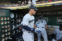 OAKLAND, CA - AUGUST 20:  Aaron Judge #99 of the New York Yankees walks in the dugout before the game against the Oakland Athletics at the Oakland Coliseum on Tuesday, August 20, 2019 in Oakland, California. (Photo by Brad Mangin)