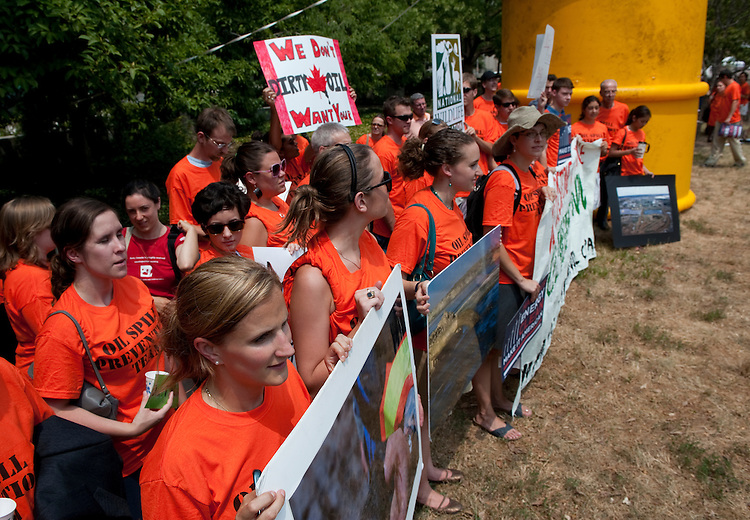 "UNITED STATES - July 8 : Protestors gathered near a large inflatable oil barrel outside the Canadian Embassy, 501 Pennsylvania Ave. NW and donned bright orange ""Oil Spill Prevention Team"" t-shirts. The protesters later marched to the White House carrying signs and a banner reading ""No Keystone XL Pipeline, Clean Energy Now."" (Photo By Douglas Graham/Roll Call via Getty Images)"