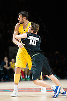 Melbourne, 15 August 2015 - Andrew BOGUT of Australia and Thomas ABERCROMBIE of New Zealand in action during game one of the 2015 FIBA Oceania Championships in men's basketball between the Australian Boomers and the New Zealand Tall Blacks at Rod Laver Arena in Melbourne, Australia. Aus def NZ 71-59. (Photo Sydney Low / sydlow.com)